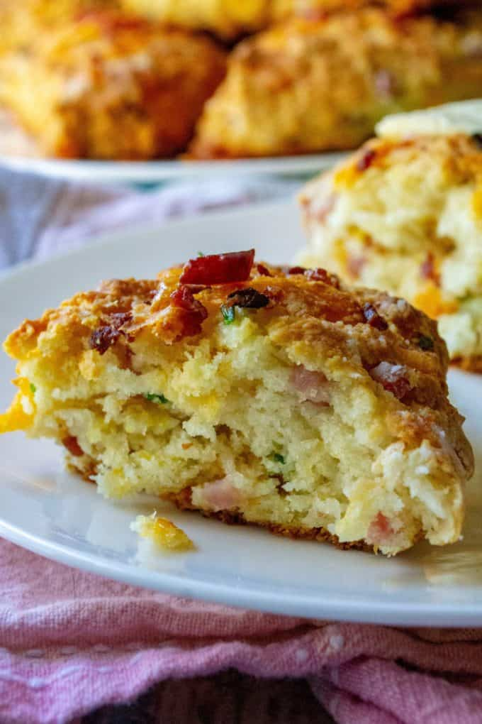 Ham and Cheese Savory Scones are the perfect savory scones you have been looking for! Made with tons of cheddar cheese, crispy bacon, tender ham and chopped chives, these Ham and Cheese Scones are the perfect easy brunch idea any day of the week. | A Wicked Whisk