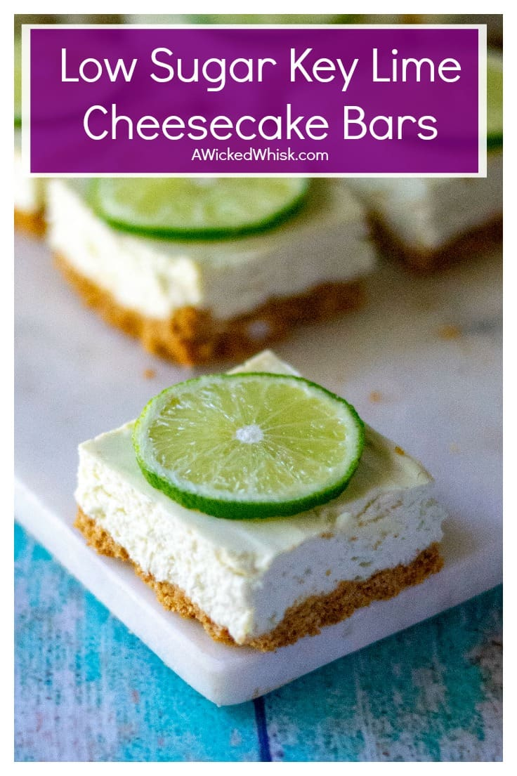 Key Lime Cheesecake Bars are creamy, low sugar and taste just like your favorite key lime pie cheesecake! Made with greek yogurt, fresh key limes and cream cheese, theseKey Lime Cheesecake Bars are the perfect easy summer desserts.   A Wicked Whisk #keylimepie #keylimecheesecake #keylimecheesecakebars #keylimecheesecakeketo #keylimecheesecakeeasy #keylimecheesecakebarslowcarb #lowsugardesserts #keylimeslowsugar #lowsugardessertsdiabetic #splendadesserts