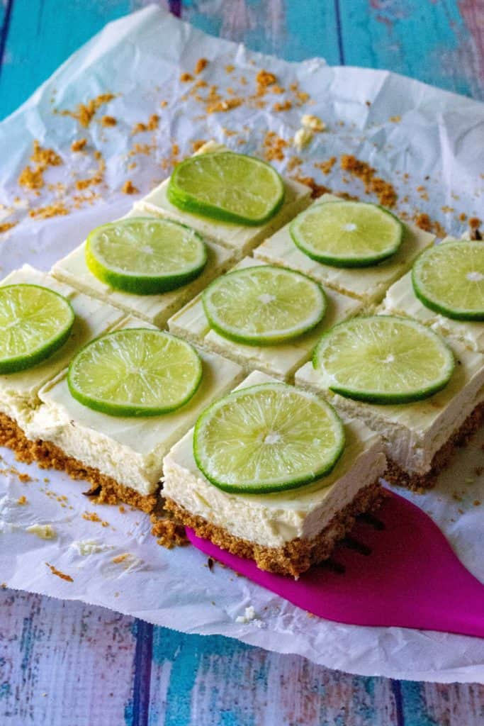 Key Lime Cheesecake Bars on a spatula