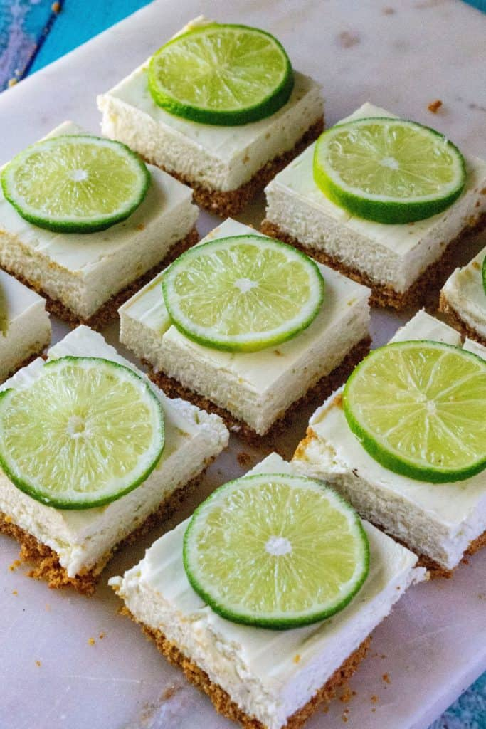 Key Lime Cheesecake Bars on a cutting board