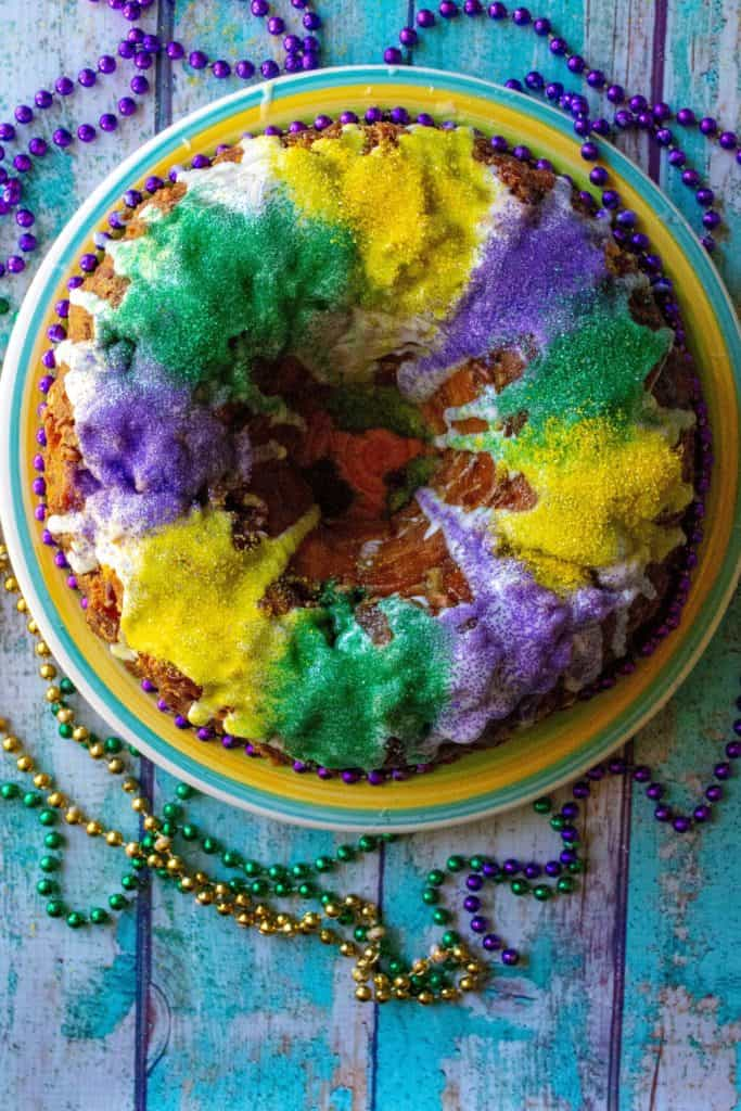 King Cake Monkey Bread ring on a plate