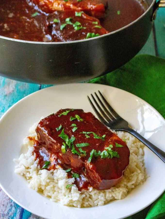 Slow Cooker Honey Garlic Pork Chops are sweet, savory and the perfect easy pork chop dinner to serve up this week! Simmered in a spicy honey garlic sauce, these Slow Cooker Honey Garlic Pork Chops are tender, juicy and packed with tons of delicious flavor. | A Wicked Whisk