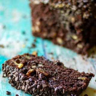 Triple Chocolate Banana Bread is super moist banana bread with TRIPLE chocolate throughout. Super easy chocolate banana bread speckled with mini chocolate chips and then slathered in homemade chocolate buttercream frosting makes this Triple Chocolate Banana Bread a chocolate lovers dream!| A Wicked Whisk