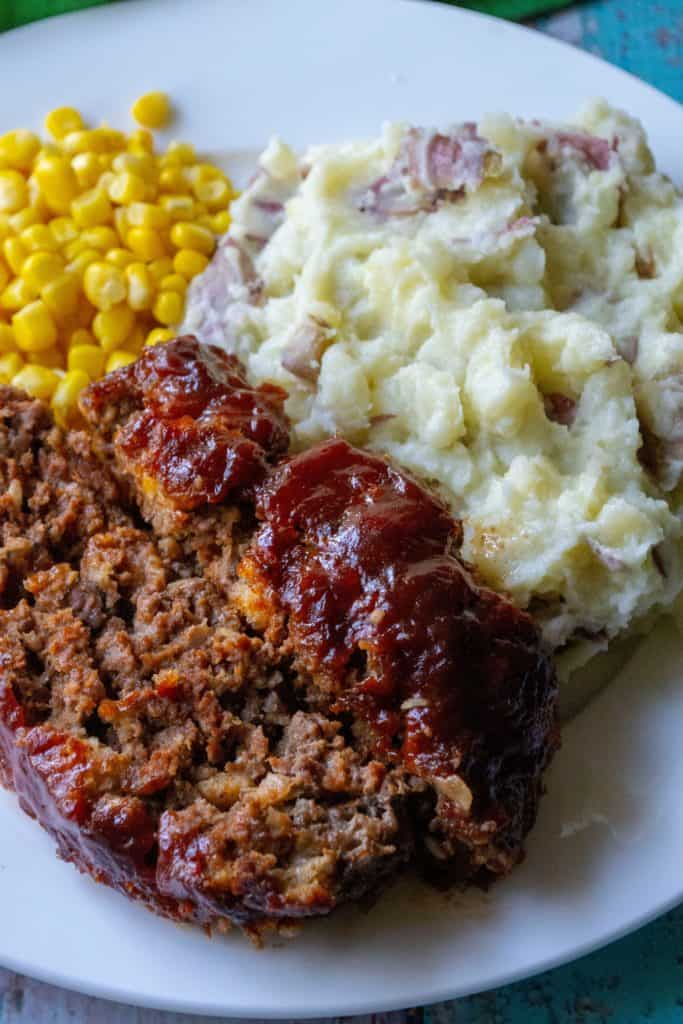 Better Than Your Momma's Classic Meatloaf dinner on a plate