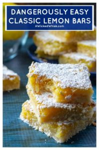 Dangerously Easy Classic Lemon Bars are named dangerous because these classic lemon bars are so tasty you will want to eat the whole pan in one sitting. Super tart and tangy, these Dangerously Easy Classic Lemon Bars are made using just a few staple pantry ingredients and tons of lemon zest! | A Wicked Whisk #lemonbars #lemonbarsrecipeeasy #classiclemonbars #lemonbarseasysimple #lemonbarsrecipebest #lemonbarsrecipeshortbreadcrust #lemonbarsrecipeyumyum