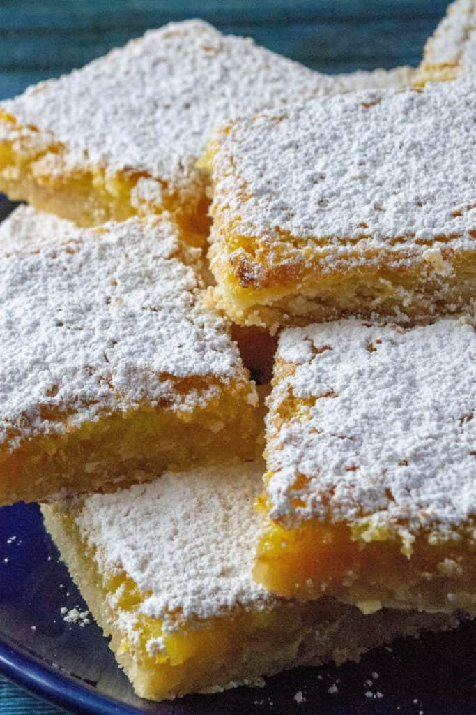 Dangerously Easy Classic Lemon Bars stacked on a plate