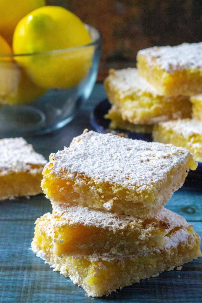 Dangerously Easy Classic Lemon Bars are named dangerous because these classic lemon bars are so tasty you will want to eat the whole pan in one sitting. Super tart and tangy, these Dangerously Easy Classic Lemon Bars are made using just a few staple pantry ingredients and tons of lemon zest! | A Wicked Whisk