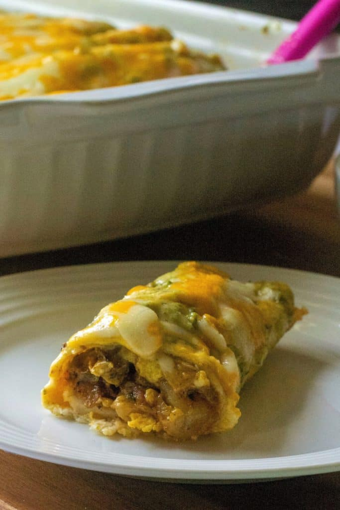 Breakfast Enchiladas with Poblano Sauce on a plate | A Wicked Whisk