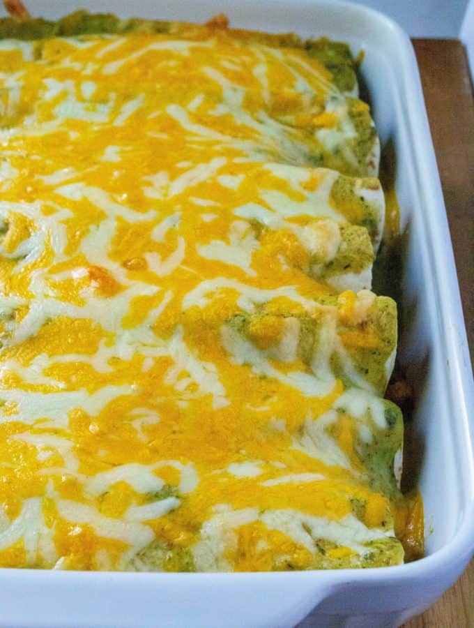 Breakfast Enchiladas with Poblano Sauce are hearty, spicy and perfect for feeding a crowd.  Made with eggs, bacon, sausauge crumbles and spicy potatoes, these Breakfast Enchiladas are the tastiest way to start the day. | A Wicked Whisk