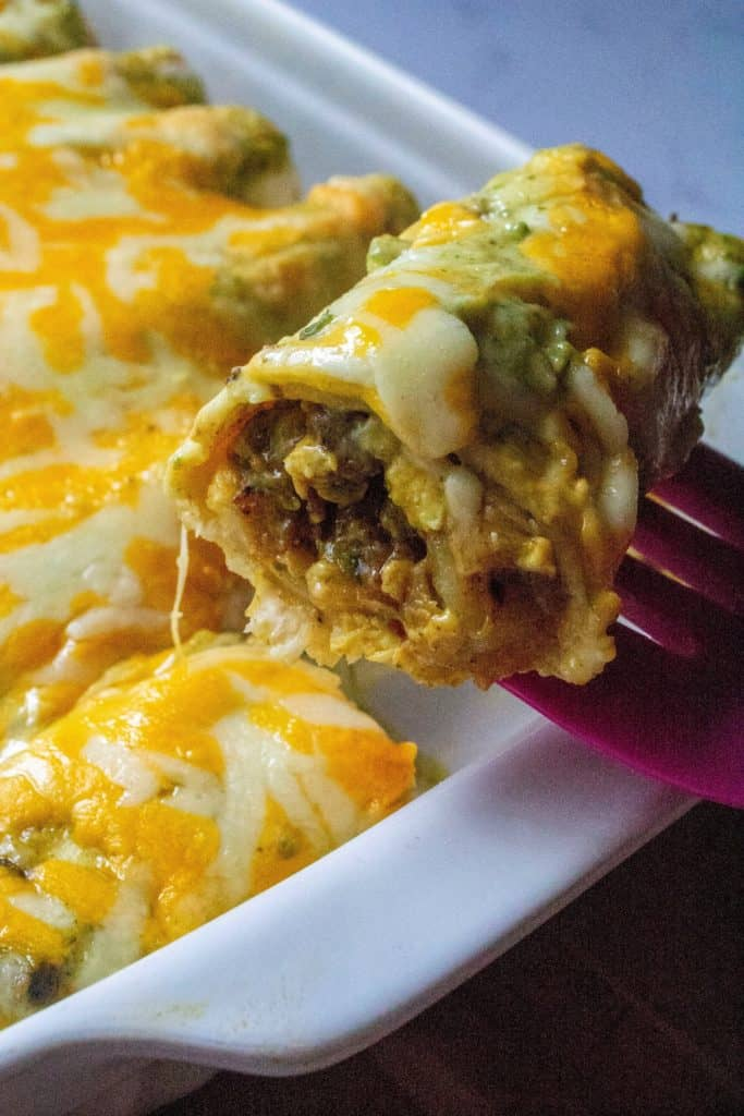 Breakfast Enchiladas with Poblano Sauce on a serving| A Wicked Whisk