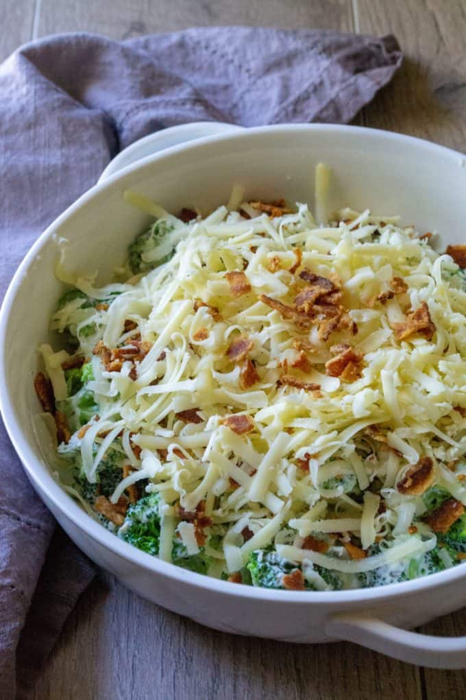 Cheesy Bacon Broccoli Casserole covered in cheese