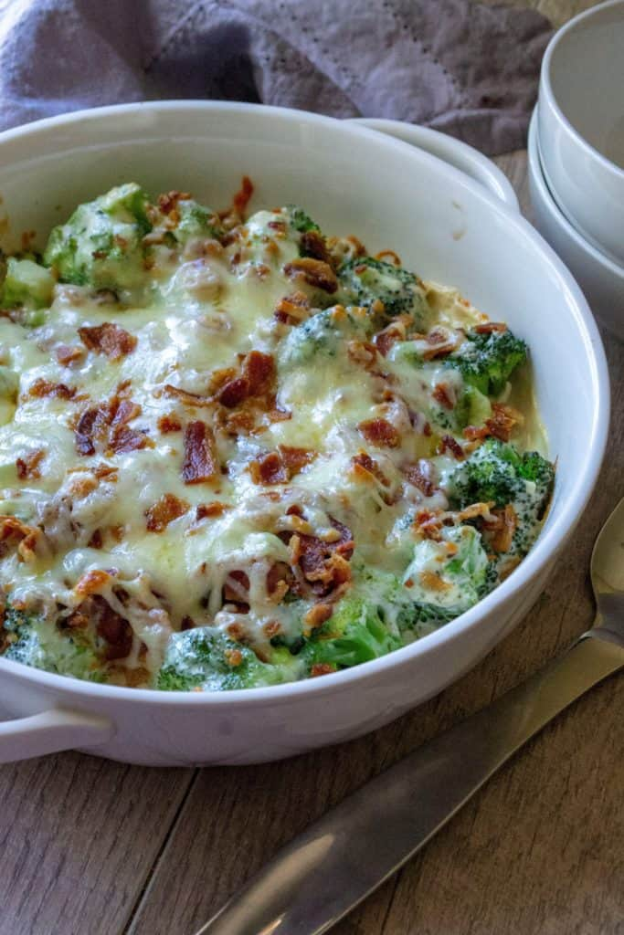 Cheesy Bacon Broccoli Casserole in a white serving dish