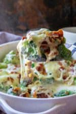 Cheesy Bacon Broccoli Casserole is the best way to eat your broccoli! Sprinkled with crispy bacon, covered in melted cheese and served up in a delicious garlic herb sauce, Cheesy Bacon Broccoli Casserole is the perfect low carb keto friendly side dish to hit your dinner table. | A Wicked Whisk