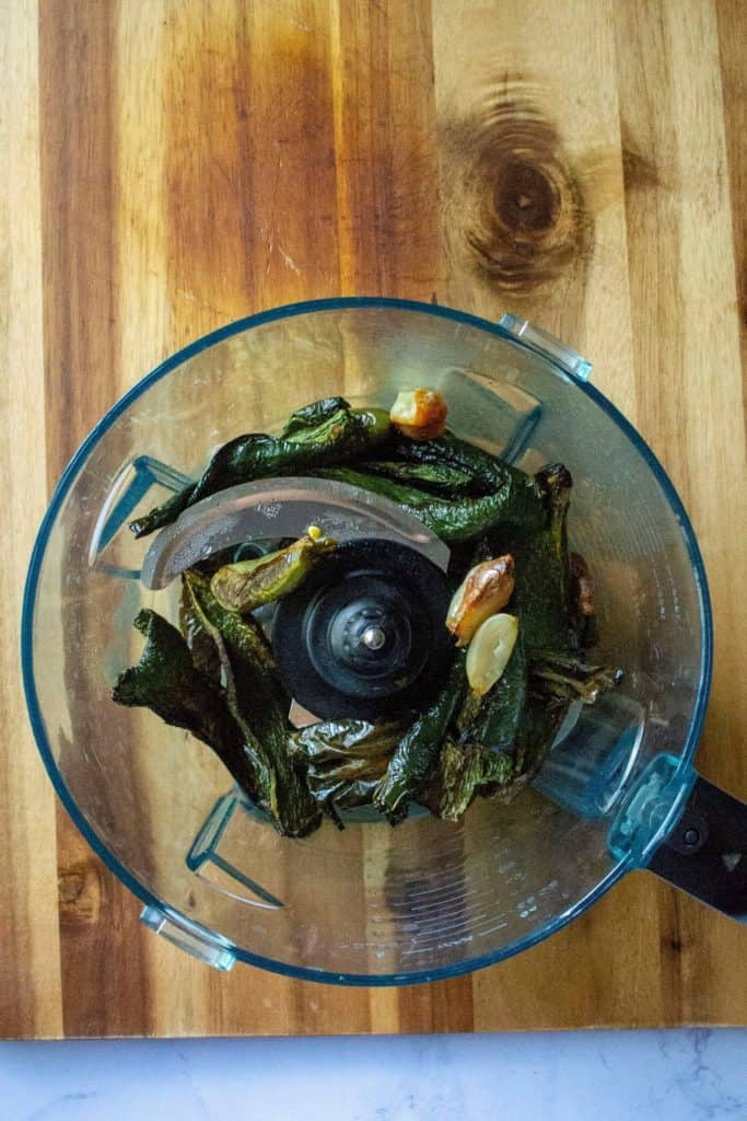 Creamy Roasted Garlic Poblano Sauce roasted peppers in a food processor | A Wicked Whisk
