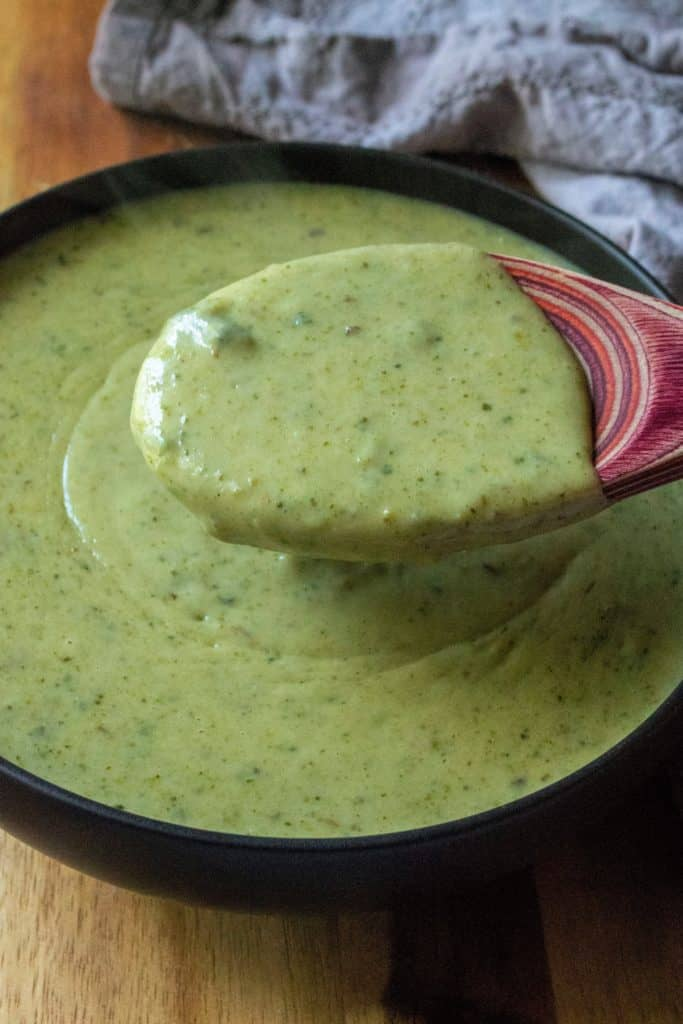 Creamy Roasted Garlic Poblano Sauce on a spoon | A Wicked Whisk