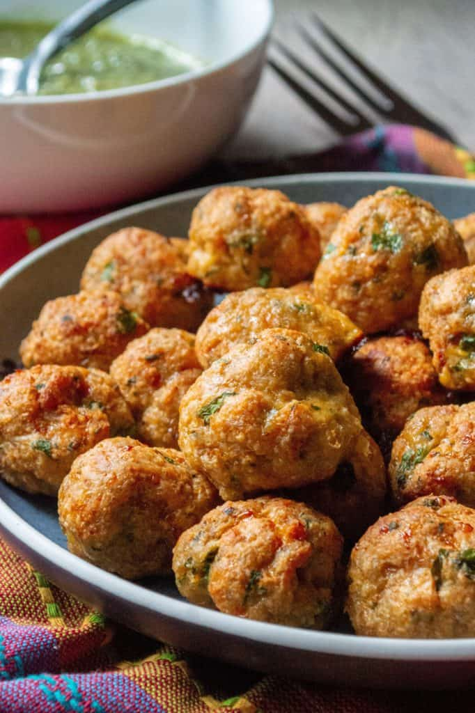 Keto Chicken Meatballs are your favorite ground chicken meatballs made with everyday ingredients but without the breadcrumbs. Loaded with spices, parmesan cheese and fresh herbs, these Keto Chicken Meatballs are low-carb, gluten free and keto friendly but you would never even know it! | A Wicked Whisk