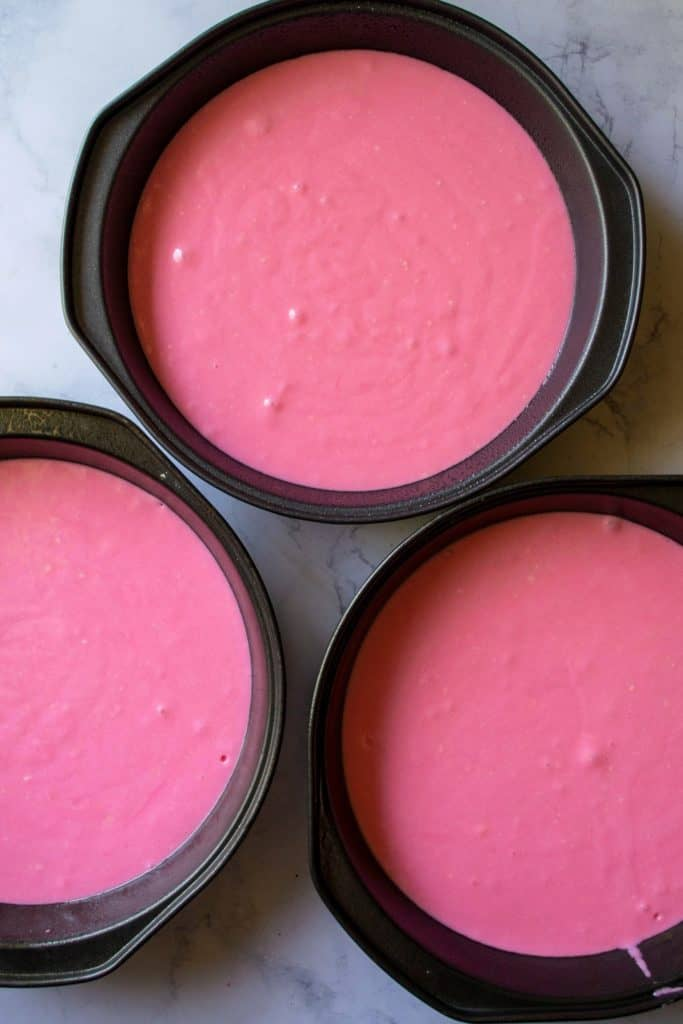 Pink Lemonade Cakein three baking pans| A Wicked Whisk