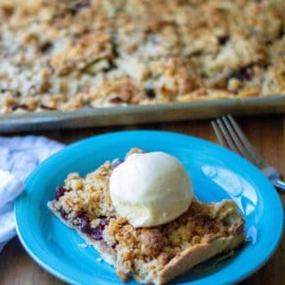 Cranberry Walnut Apple Slab Pie is a favorite easy party dessert designed to feed apple pie to a crowd. Made using refrigerated pie crusts, fresh apples and dried cranberries, this Cranberry Walnut Apple Slab Pie is the ultimate deconstructed homemade apple pie perfect for holiday parties, family gatherings and any occasion you need lots of dessert to feed a crowd.