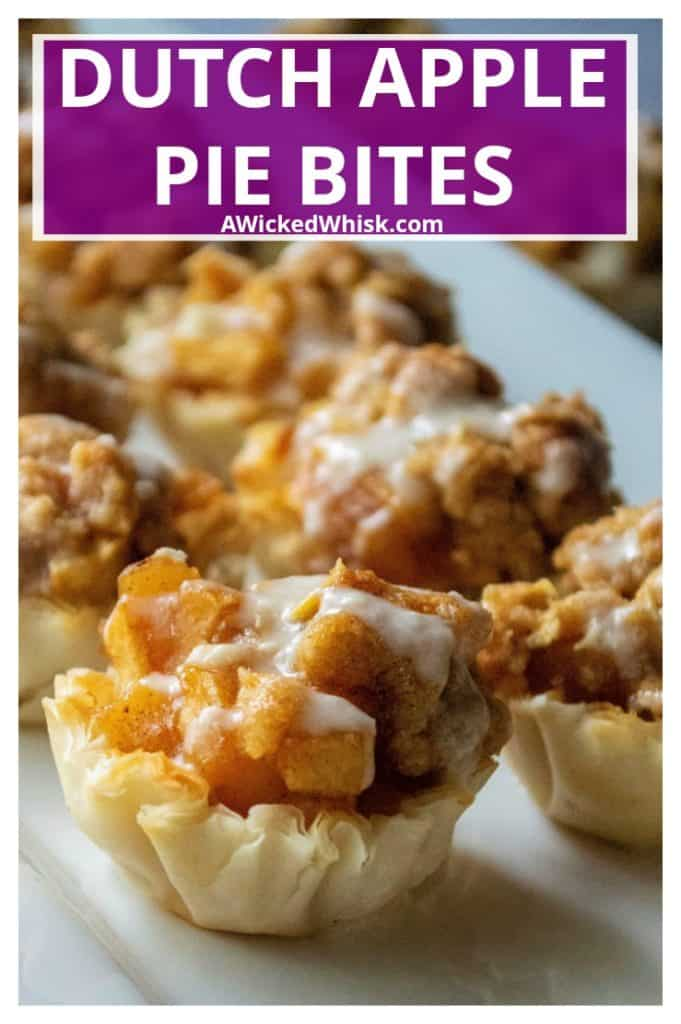 Dutch Apple Pie Bites have all of the flavor of homemade apple pie with none of the hassel.  Made using pre-made phyllo cups, a traditional apple pie filling and a crumbly topping, these Dutch Apple Pie Bites are easy to make and impossible to resist! | A Wicked Whisk #applepie #applepiebites #applepiecups #miniapplepies #miniapplespieseasy #miniapplepiecups #miniapplepiepuffpastry #phyllocupdesserts #dutchapplepiecups #dutchapplepiemini #fourthofjulyappledesserts