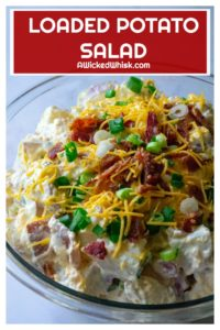 Loaded Potato Salad is tender, creamy red potaotes fully loaded with tons of cheese, bacon and green onions.. The perfect addition to any occasion, this Loaded Potato Salad is the ultimate bbq side dish, pool party snack and summertime dinner table must have! | A Wicked Whisk #loadedpotatosalad #loadedbakedpotatosalad #bakedpotatosalad #bakedpotatosaladwithsourcream #bakedpotatosaladrecipe #easybakedpotatosalad #coldbakedpotatosalad #easybakedpotatosaladbacon