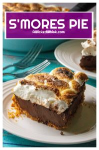 S'mores Pie is toasted marshmallows over a creamy chocolate ganache filling and a thick graham cracker crumb crust. Inspired by your favorite campfire dessert, this S'mores Pie is the decadent, grown-up version of that best-loved summertime treat. | A Wicked Whisk #smores #smorespie #smorespieeasy #smorespierecipe #smorespiegraham #smorespierecipegrahamcrackercrust #smorespierecipegrahamcrackercrustmarshmallows #smorespierecipetoastedmarshmallow