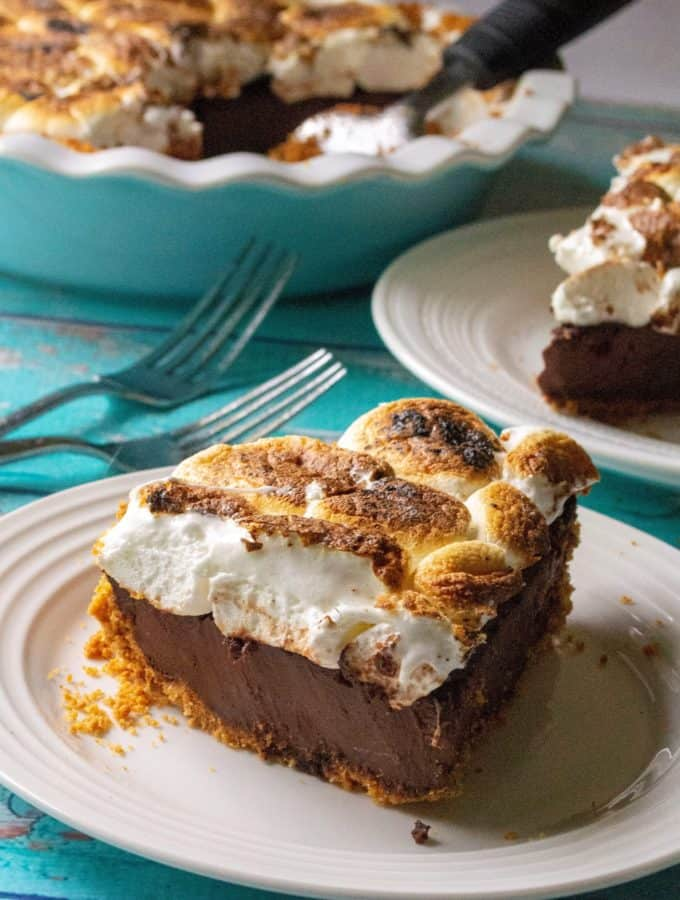 S'mores Pie is toasted marshmallows over a creamy chocolate ganache filling and a thick graham cracker crumb crust. Inspired by your favorite campfire dessert, this S'mores Pie is the decadent, grown-up version of that best-loved summertime treat.