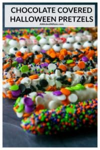 Chocolate Covered Halloween Pretzels are fun and festive chocolate covered pretzels decorated with spooky sprinkles for the perfect easy Halloween treat! | A Wicked Whisk #halloweenpretzels #halloweenpretzelrods #halloweenpretzeltreats #halloweenpretzelsticks #halloweenpretzelschocolatedipped #halloweenpretzelrecipes #halloweenpretzelideas #halloweenpretzelseasy #easyhalloweentreats #easyhalloweentreatsforkids #easyhalloweentreatsforschool