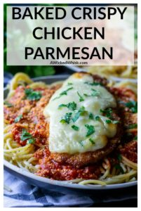 Baked Crispy Chicken Parmesan is easier than you think to make and a family favorite recipe. Pan fried and then oven baked, this quick and easy chicken Parmesan is crispy on the outside but moist and tender on the inside. Ready in just 30 minutes, this is the perfect quick dinner recipe any day of the week. #chickenparmesan #bakedchickenparmesan #bestchickenparmesan #crispychickenparmesan #crispychickenparmesanovenbaked #crispychickenparmesanfried #chickenparmesaneasy #chickenparmesaneasyoven