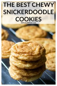 These Chewy Snickerdoodle Cookies are chewy, buttery cookies coated in cinnamon and sugar and soft-baked to perfection. This classic cookie recipe delivers chewy centers and perfectly crisp edges for the BEST snickerdoodles. | A Wicked Whisk #snickerdoodles #snickerdoodlecookies #snickerdoodlecookieseasy #snickerdoodlecookiessoft #bestsnickerdoodlecookies #bestsnickerdoodlecookieschewy #chewysnickerdoodlecookies #snickerdoodlecookieschristmas #softandchewysnickerdoodlecookies