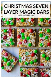 Christmas Seven Layer Magic Bars are a buttery graham cracker crust layered with chocolate chips, coconut flakes, walnuts and butterscotch chips then topped off with a sprinkling of red and green M&Ms. Perfect layered bar cookie Christmas magic served up in this easy holiday dessert! #christmasmagicbars #magicbars #magicbars7layer #christmasmagicbarsholidays #magicbars7layerchristmas #christmasmagicbarsrecipe #magicbarsbutterscotch #redandgreenmagicbars #sevenlayerbarschristmas