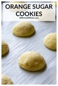 Soft Baked Orange Sugar Cookies are the perfect melt in your mouth orange cookies. This orange cookie recipe delivers sugar cookies with soft centers, crisp edges and bursts with orange flavor! | A Wicked Whisk #orangesugarcookies #orangesugarcookiesrecipes #orangecookies #orangecookieseasy #softorangecookies #orangecookieschristmas #bestorangecookies #sugarcookies #christmassugarcookies #softsugarcookies #bestsugarcookies #bestsugarcookiessoft #orangecookiesrecipeschristmas