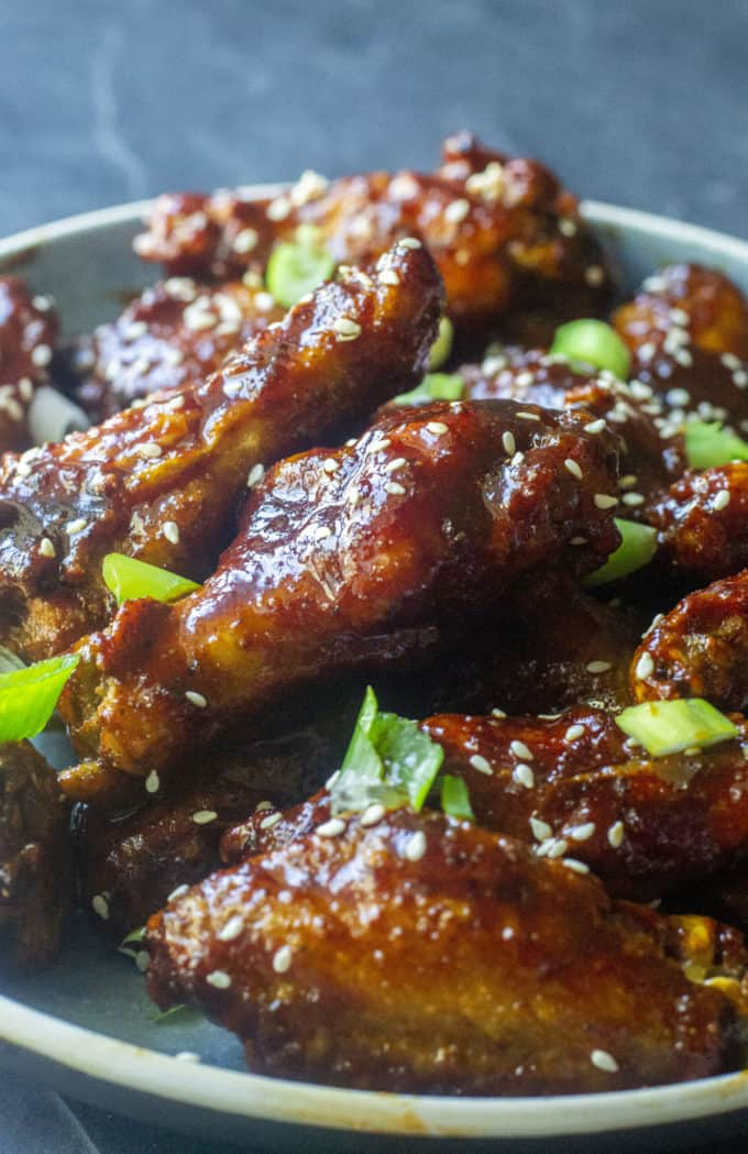 korean wings on a plate