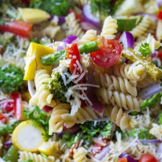 Pasta Primavera on a serving spoon