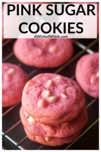 Pink Sugar Cookies are the easiest soft baked sugar cookies you will ever make. These chewy and delicious sugar cookies are crisp on the outside and soft on the inside, sprinkled with white chocolate chips and are the perfect pink cookies for Valentine's Day or ANY day. #pinkcookies #pinksugarcookies #pinkcookieseasy #pinkcookiesforbabyshower #pinkvalentinesdaycookies #pinkvalentinescookies #valentinesdaycookies #valentinesdaycookiesideas #pinkwhitechocolatechipcookies