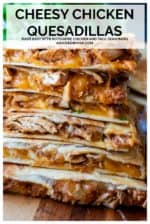 These Chicken Quesadillas made with leftover rotisserie chicken and a taco seasoning packet are my go-to, easy dinner recipe for busy weeknights and lazy weekends! Perfect easy dinner ideas are ones the entire family will eat and this taco chicken quesadilla recipe is everyone's favorite. Crispy edges, seasoned chicken and tons of melted cheese! #chickenquesadillaswithtacoseasoning #chickenquesadillas #rotisseriechickenquesadilla #easychickenquesadilla #shreddedchickenquesadilla