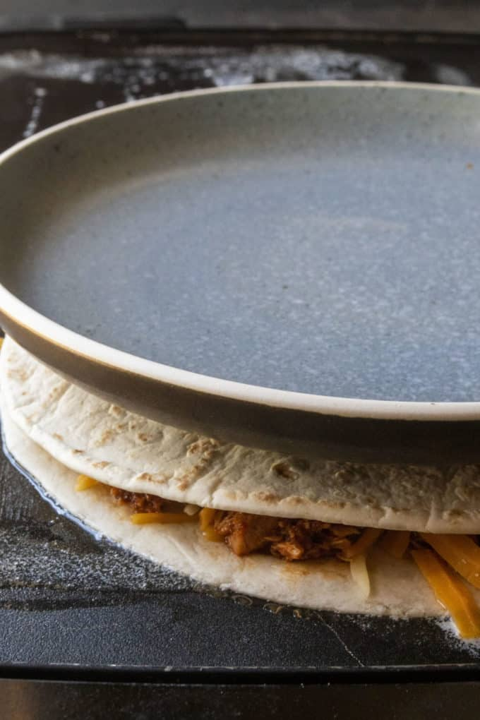 plate on top of cooking quesadilla