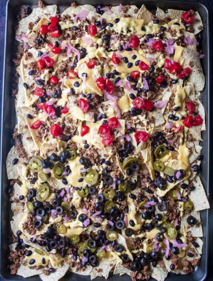 loaded nachos on a sheet pan