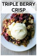Triple Berry Crisp is an irresistibly EASY mixed berry dessert. Made with frozen raspberries, blueberries and blackberries then topped with a crispy oat topping, this easy summer dessert recipe is perfect served up with a scoop of ice cream! #tripleberrycrisp #tripleberrycrispfrozen #tripleberrycrisprecipe #mixedberrycrisp #mixedberrycrisprecipefrozenfruit #mixedberrycrispfrozen #easymixedberrycrisp