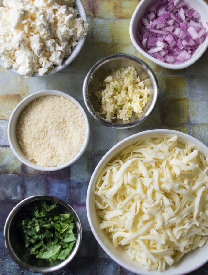 ingredients for white pizza in bowls