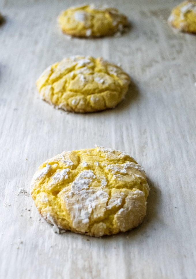 baked lemon crinkle cookie on a sheet pan