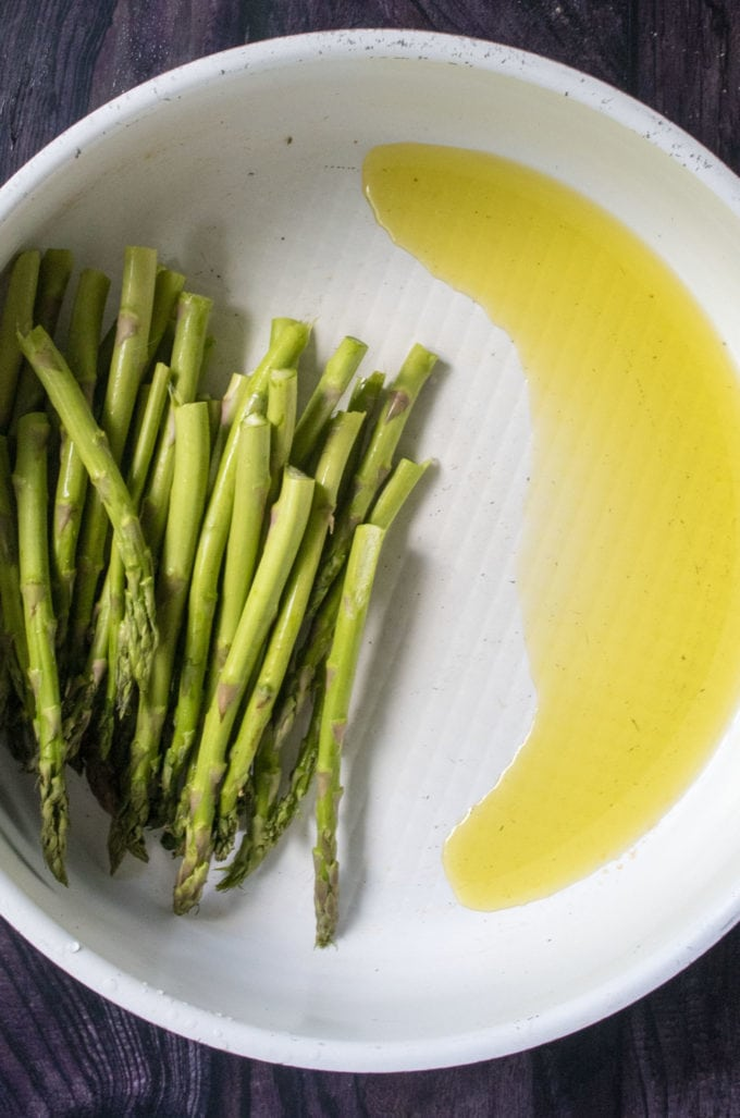 asparagus and olive oil in a skillet