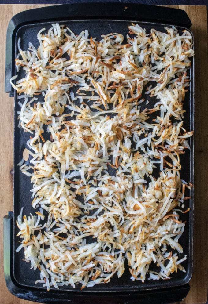 shredded hash browns on a griddle