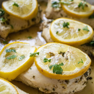 baked lemon chicken with lemon slices