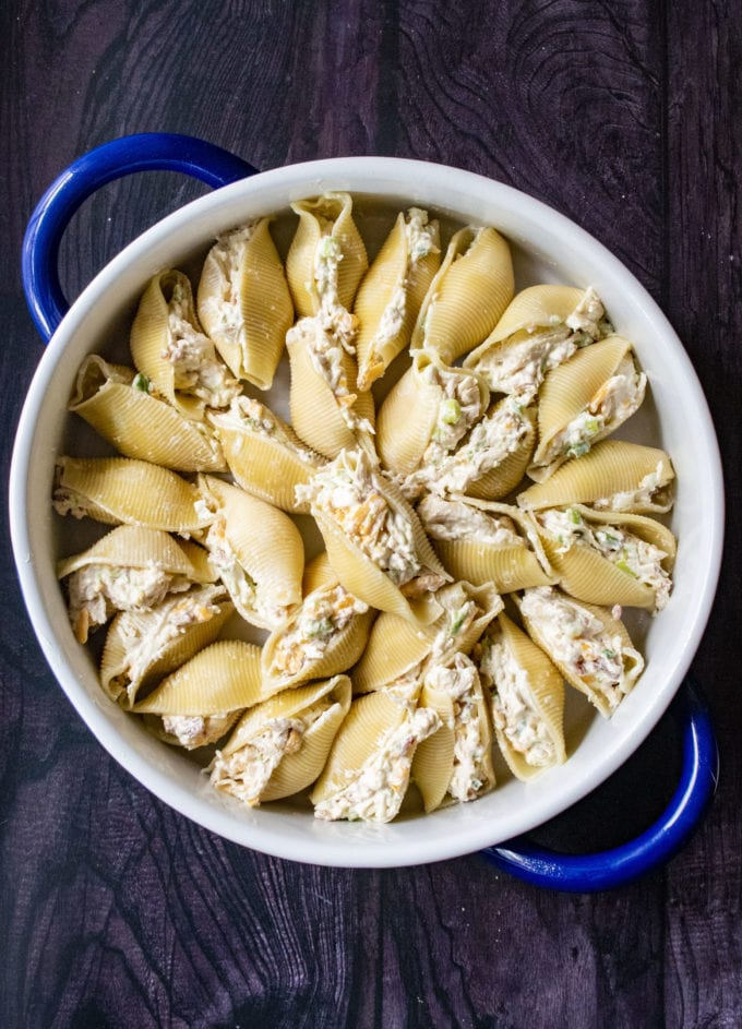 stuffed jalapeno shells in a baking dish