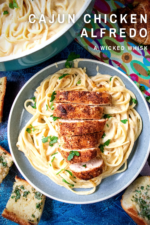 Cajun Chicken Alfredo is a quick and easy dinner that packs tons of flavor. Tender fettuccini pasta served up in a creamy Cajun Alfredo sauce topped off with perfectly seasoned chicken! The best part? Seeing how easy it is to make Alfredo sauce from scratch! #cajunchickenalfredo #cajunchickenpasta #cajunpasta #cajunalfredosauce #alfredosaucefromscratch #homemadealfredosauce